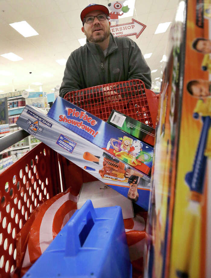 Elise Amendola | AP Paul Poirier pushes his cart as he shops in Wilmington, Massachusetts. While larger stores opened their doors Friday for what is still one of the busiest days of the year, small and independent businesses hope they see a seasonal boost today.