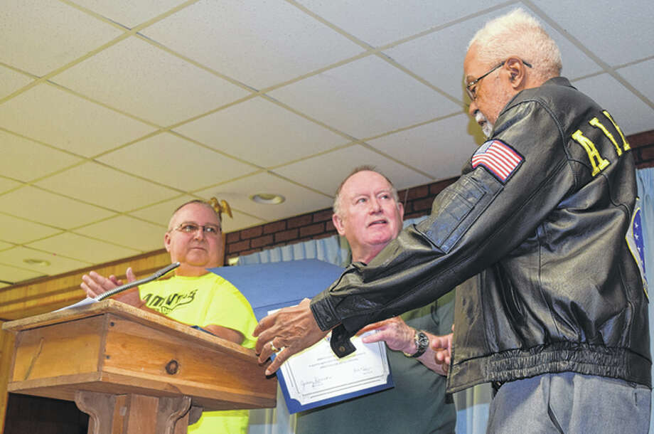 AMVETS Post 100 Commander Jim Duncan (center) hands Ed Wright of Jacksonville, a former AMVETS state commander, a certificate in appreciation of his dedication and service to Post 100 and the community. Wright and several other AMVETS officers and members were honored Saturday during the post's 70th anniversary celebration. At left is AMVETS trustee Lewis Camerer. Photo: Greg Olson | Journal-Courier