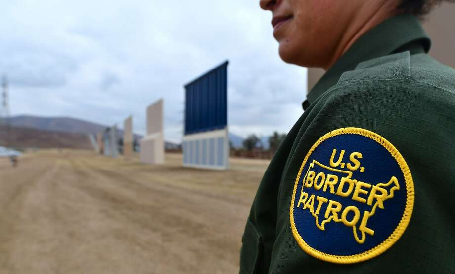 "In this file photo taken on November 1, 2017 US Border Patrol officer Tekae Michael stands near prototypes of US President Donald Trump's proposed border wall in San Diego, California.  A border patrol agent whose mysterious death prompted President Donald Trump to renew his call for a wall along the US-Mexico border appears to have died as the result of an accident, according to an FBI probe. An FBI investigation into the November 2017 death of agent Rogelio Martinez has not found any evidence of foul play.""To date none of the more than 650 interviews completed, locations searched, or evidence collected and analyzed have produced evidence that would support the existence of a scuffle, altercation, or attack,"" the FBI said in a statement on February 7, 2018. Photo: FREDERIC J. BROWN, AFP/Getty Images"
