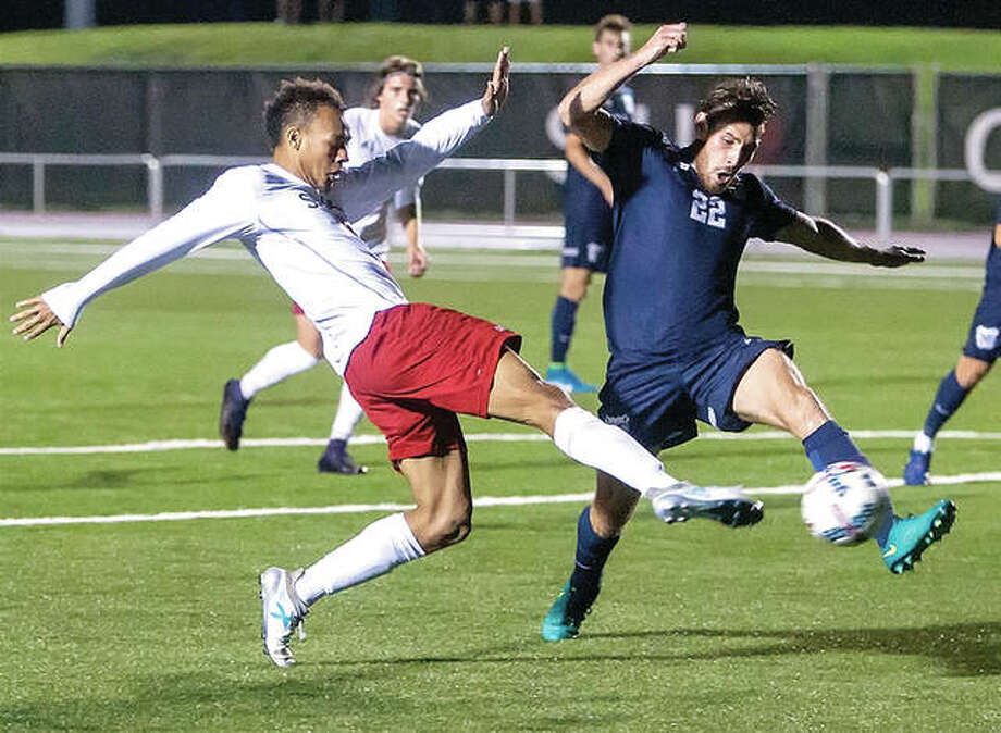SIUE's Devyn Jambga, lleft, and Butler's Kieran Geldenhuys (22) battle for the ball in action Tuesday night at Korte Stadium. SIUE won 2-0. Photo: SIUE Athletics