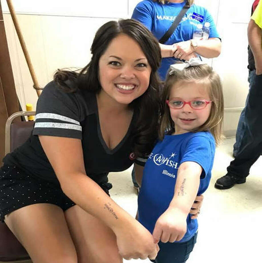 Sarah Gebke of GCS Credit Union and Wish Child Jessica show off their matching temporary tattoos at the fourth annual Ride for Wishes at the Alton Moose Lodge Saturday. Photo: For The Telegraph