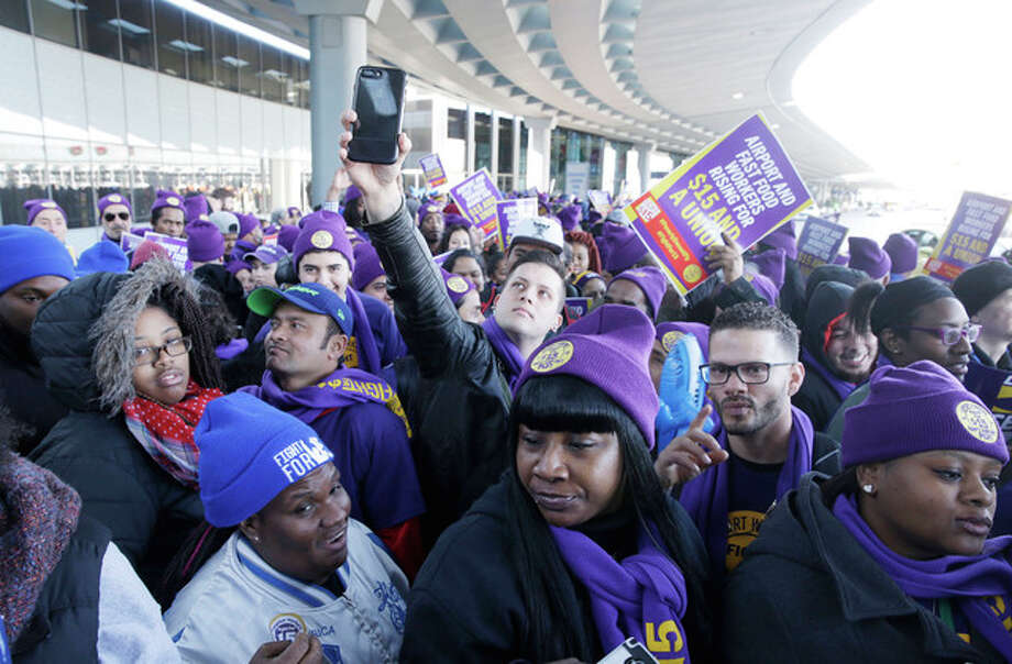 Kiichiro Sato | AP Protesters gather at Chicago's O'Hare International Airport on Tuesday as part of a nationwide protest for a $15 an hour minimum wage. Fast-food restaurant and airport workers, as well as home and child-care workers rallied in cities including Chicago, Detroit, Houston, Los Angeles, Minneapolis and New York.