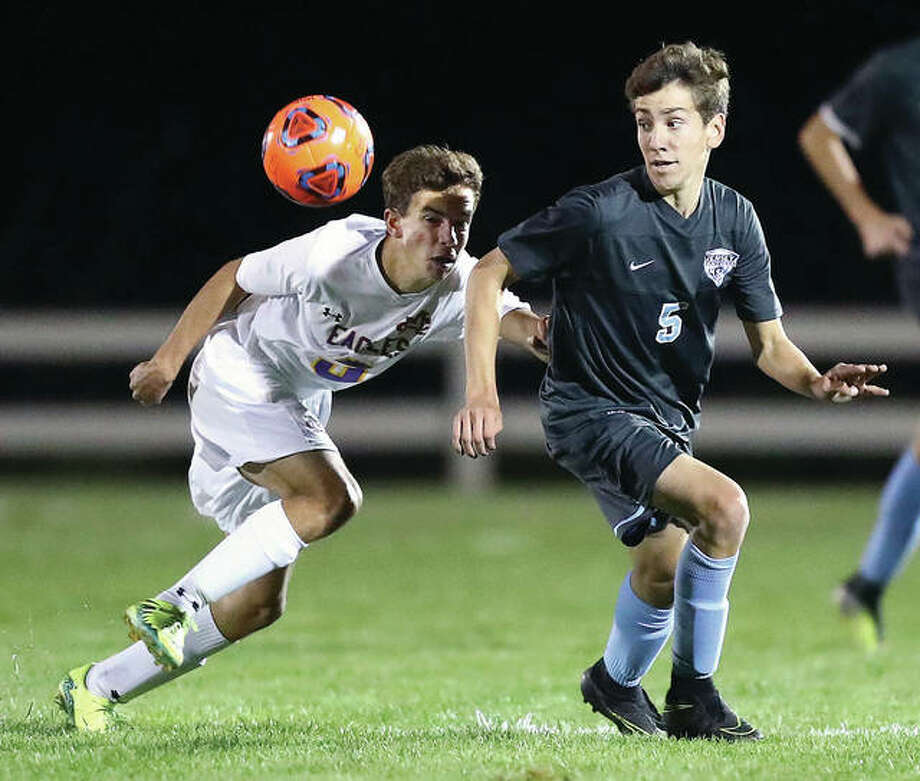 Jersey's Wyatt Freand, right, looks to gain possession of the ball while being defended by Civic Memorial's Seth Terry in Wednesday night's match at the Bethalto Sports Complex. Photo: Billy Hurst | For The Telegraph