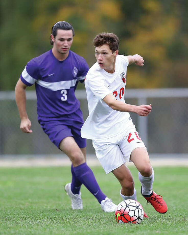 Alton's Joey Morrissey (right) maneuvers past defensive pressure applied by Collinsville's Hunter Counton during Thursday's Southwestern Conference boys soccer match at Piasa Motor Fuels Field at Alton High School. Photo: Billy Hurst | For The Telegraph