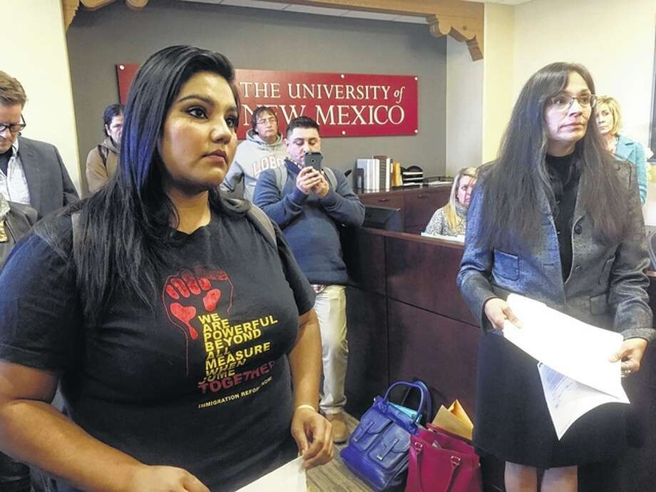 "University of New Mexico student LuzHilda Campos, left, and Chicano studies professor Irene Vasquez, right, present a letter with hundreds of signatures on Friday to school president Bob Frank asking him to declare the campus a ""sanctuary university,"" in Albuquerque, New Mexico. A group of professors at the largest university in the nation's most Hispanic state are asking for more protection of immigrant students following the election of Republican Donald Trump. Russell Contreras 