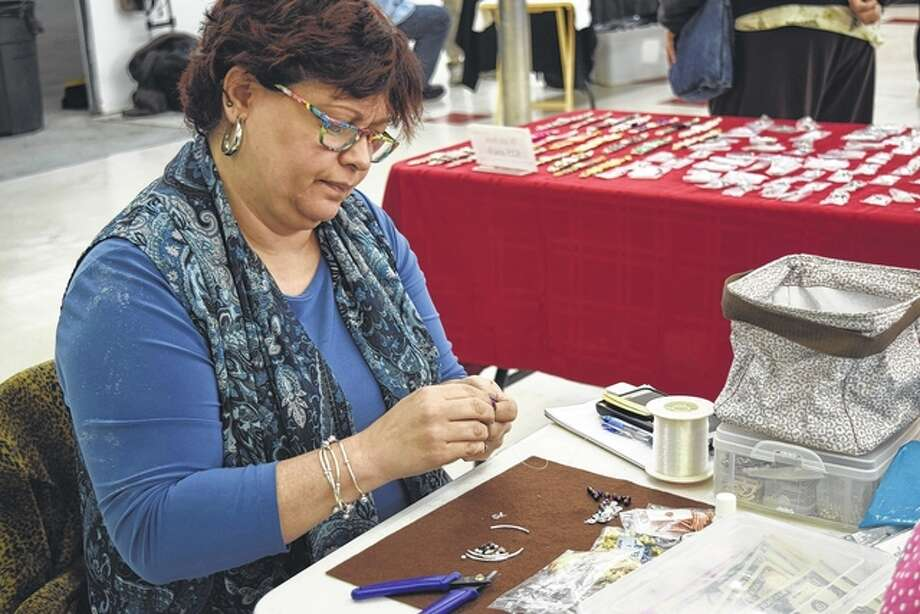 Jeanette Hampson creates a new piece of jewelry Saturday at the Journal-Courier's sixth annual Community Christmas Craft and Business Expo in Lincoln Square Shopping Center. Photo: Samantha McDaniel-Ogletree | Journal-Courier
