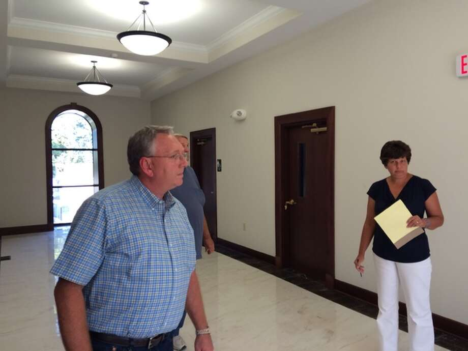 Calhoun County officials, including County Board Chairman Doug Wilschetz (left) and County Clerk Rita Hagen, assess renovations to the new courthouse during a tour in late September. Work is on track for county offices to begin moving in January.