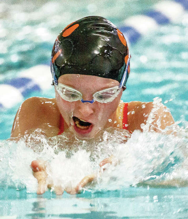 Edwardsville's Sarah Lange swims in the 200-yard breaststroke Saturday in the Swim for Hope Invitational at the Chuck Fruit Aquatic Center. Lange finished third in a time of 2:43.45. Photo: Nathan Woodside | For The Telegraph