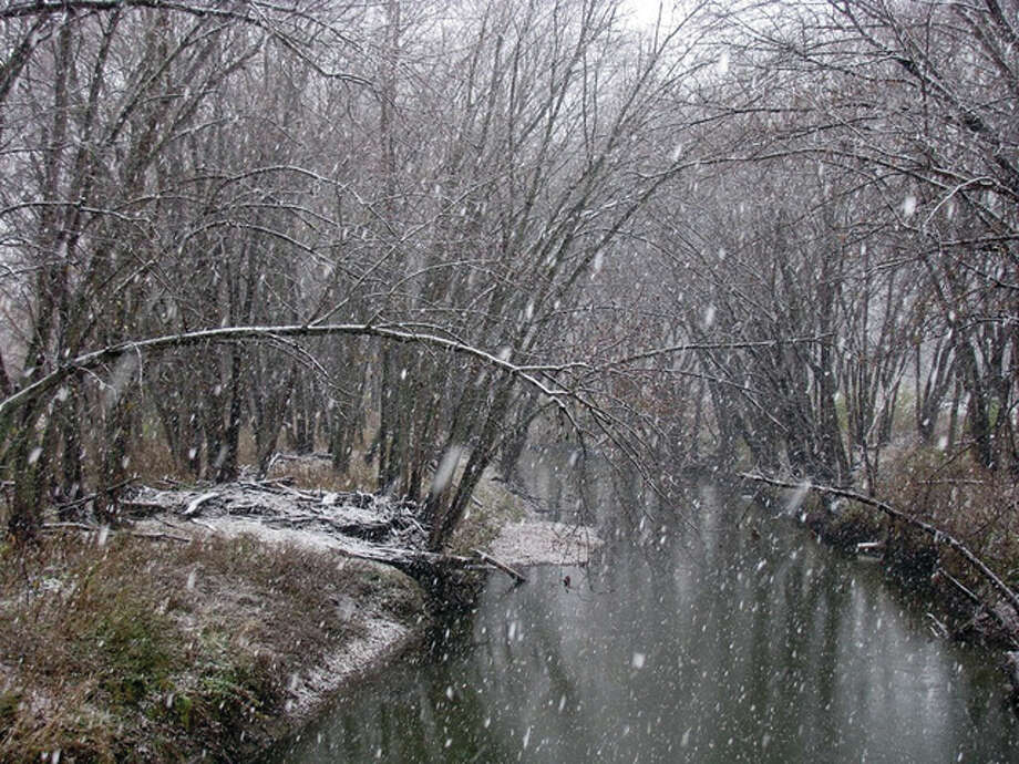 The first snow of the season leaves a dusting along Apple Creek north of Scottville. Sunday's snowfall measured about 0.5 of an inch in most parts of west-central Illinois.