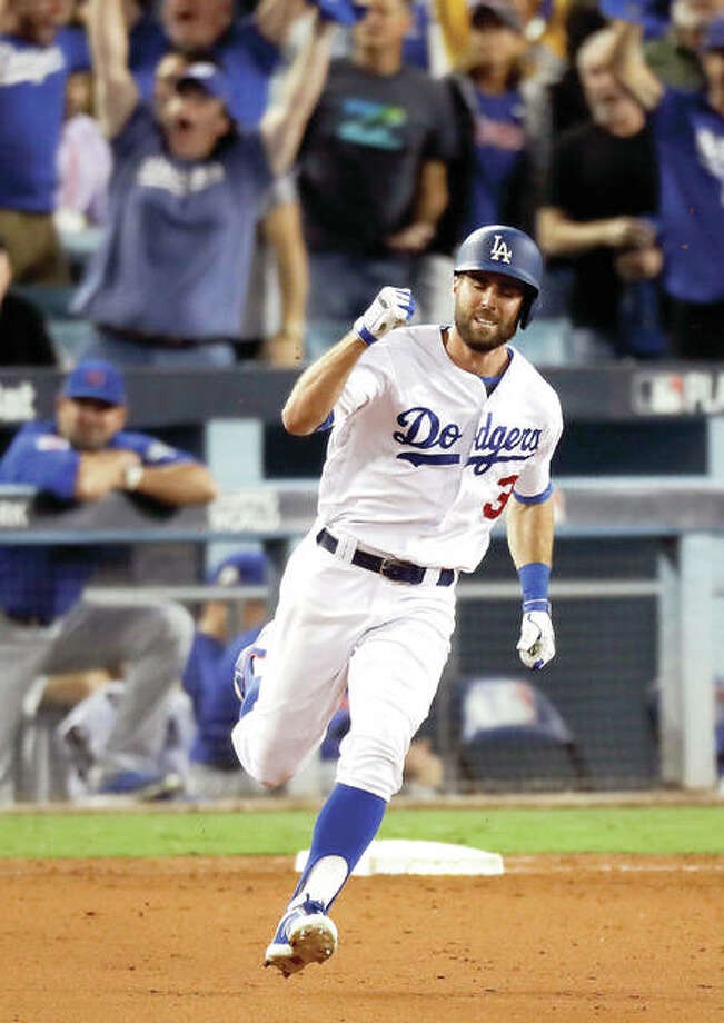 The Dodgers' Chris Taylor celebrates his home run against the Cubs in the sixth inning of Game 1 of the NLCS Saturday in Los Angeles.