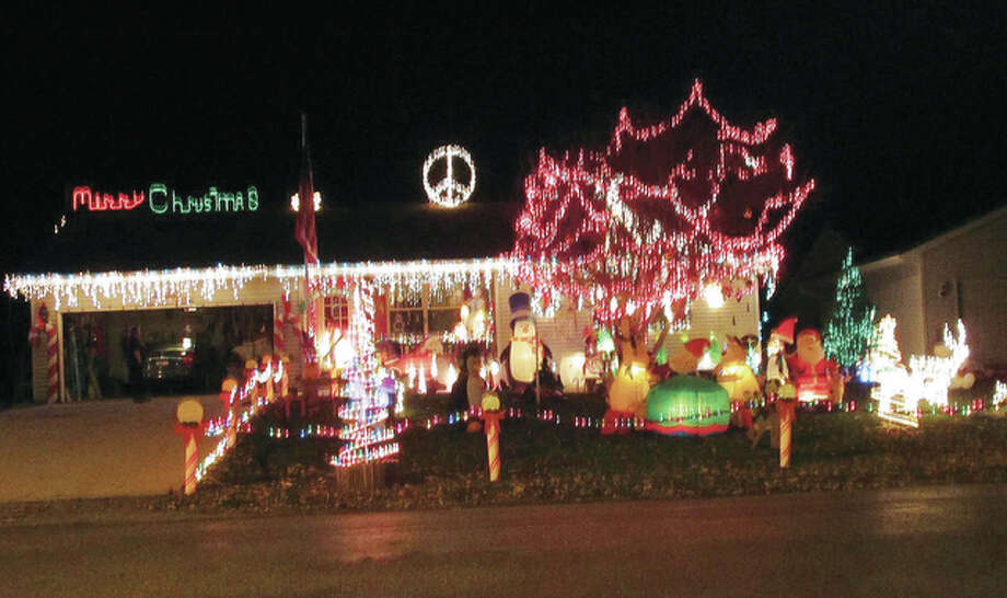 Christmas decorations at Walter and Dawn Reinhardt's house at 1709 S. Diamond St. attract hundreds of passers-by each season. This year, the couple hope to use the attention to raise money for The Salvation Army.