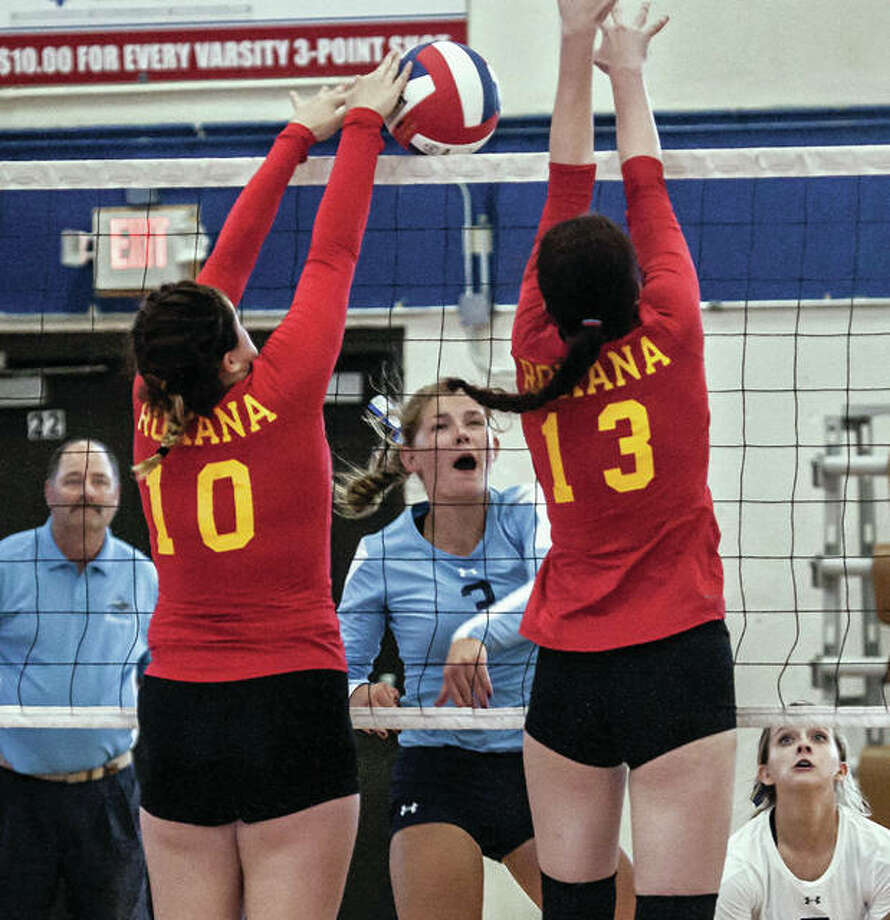 Jersey's Alexis Liles tries to power an attack through the double block put up by Roxana's Abbi Zangori (10) and Hannah Kelley during a match Aug. 21 at the Roxana Tournament.The Panthers were back in tourney action Saturday in their own Jersey Invite and finished 4-0 to win the championship. Photo: Nathan Woodside / For The Telegraph