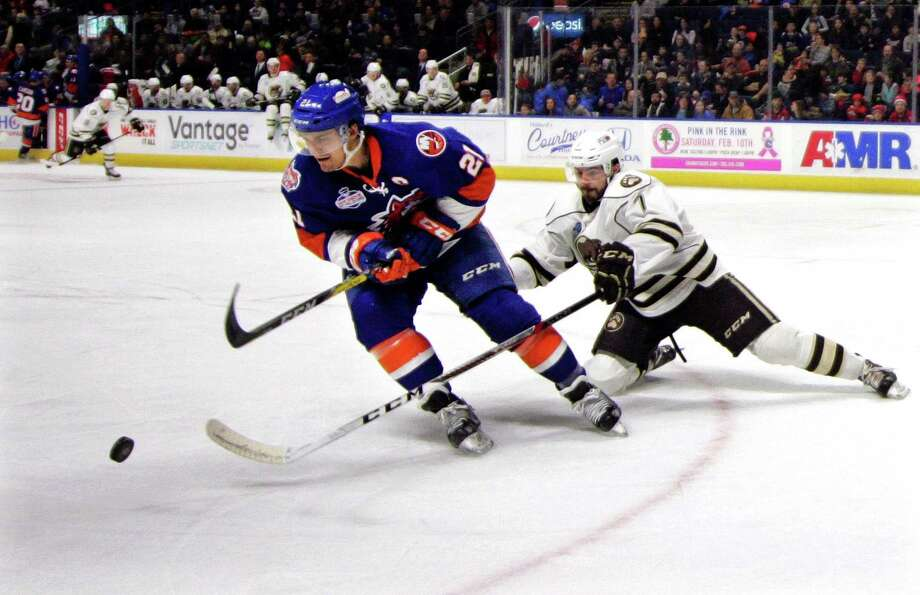 Hershey's Connor Hobbs reaches in to get the puck ahead of Sound Tigers' Ben Holmstrom during AHL hockey action at the Webster Bank Arena in Bridgeport, Conn. on Saturday Jan. 27, 2018. Photo: Christian Abraham / Hearst Connecticut Media / Connecticut Post