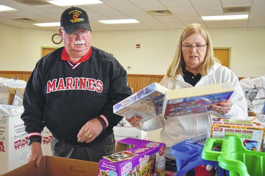 C.O. and Carol Smith organize toys Wednesday for distribution through the Toys for Tots program today through Saturday. Photo: Nick Draper | Journal-Courier