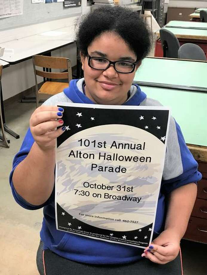 Alton High School student Rosaleigh Jones proudly showcases her work as the annual Alton Halloween Parade poster contest winner. The AHS freshman used Photoshop to illustrate a witch flying on a broomstick, shown within a full moon against a black, starry-night backdrop. Photo: Brittany Johnson | The Telegraph