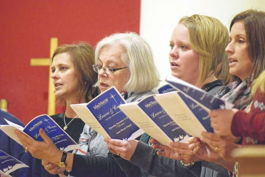 """Members of the MacMurray College faculty and the Lincoln Avenue Baptist Church choir sing Christmas carols Thursday night during """"Lessons & Carols,"""" MacMurray's Advent worship service at Annie Merner Chapel. Photo: Greg Olson 