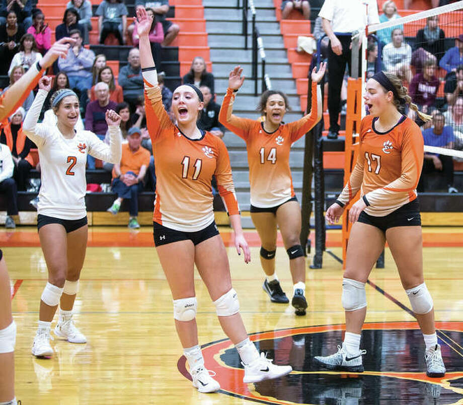 Edwardsville's (from left) Megan Woll, Rachel Verdun, Maria Smith and Rachel Pranger celebrate a point during the first set of the Tigers' 25-9, 25-15 Southwestern Conference victory over Belleville West on Tuesday at Lucco-Jackson Gym in Edwardsville. Photo: Scott Kane / For The Telegraph
