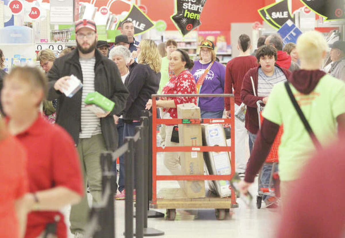 """Crowds line up to check out during Thanksgiving shopping at the Alton Target store. """"Grey Thursday,"""" or Thanksgiving, is overtaking """"Black Friday"""" as the start of the Christmas holiday shopping season."""