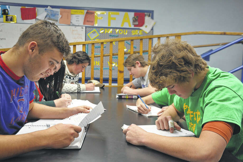 Pittsfield High School students work on their corn project, which has a goal of establishing corn as the state's official grain. Photo: Jeff Ruzicka | For The Journal-Courier