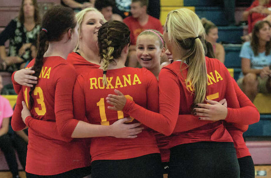 The Roxana Shells come together before a match earlier this season at the Roxana Tournament at Milazzo Gym in Roxana. On Wednesday, the Shells defeated Metro East Lutheran in two sets at Hooks Gym in Edwardsville to match the school record for wins in a season at 24. Photo: Nathan Woodside / For The Telegraph