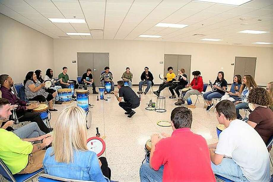 Honors College students participated in a HealthRHYTHMS drum exercise with L&C's YouthBuild program at the Scott Bibb Center last month. Photo: For The Telegraph