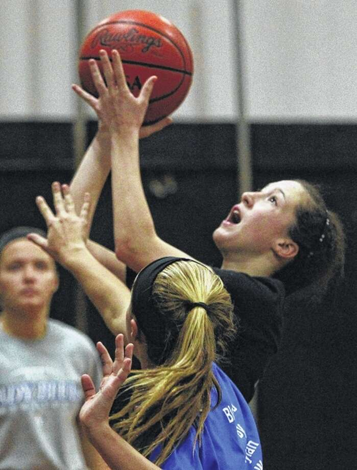 Winchester's Calista Fox puts up a shot during practice Tuesday. The Wolverines play for the state championship tonight. Photo: Dennis Mathes | Journal-Courier