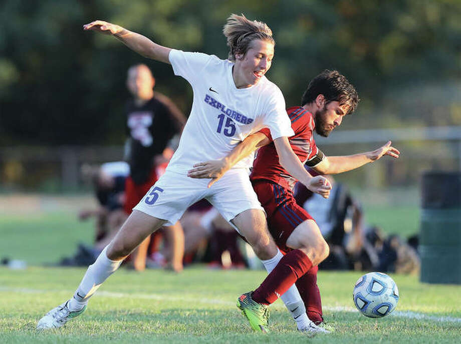 Marquette's Trenton Dietiker (left) battles for possession with Waterloo Gibault's Zack Gillan during a match Aug. 30 in Alton. On Friday, the Explorers defeated Belleville Althoff 2-1 to win the Freeburg Class 1A Sectional. Photo: Billy Hurst | For The Telegraph