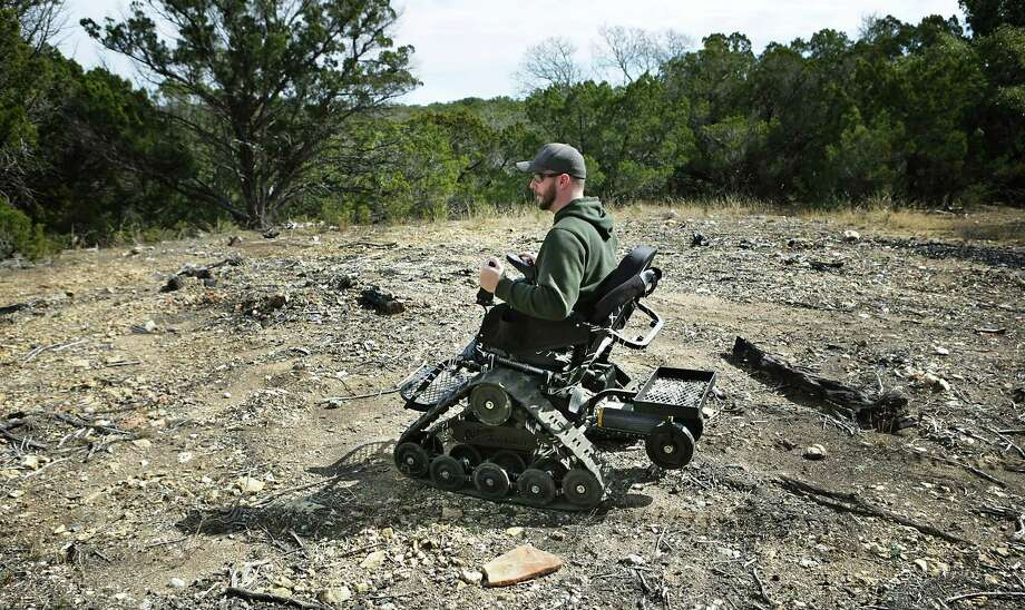 Luke Cifka, a retired Army staff sergeant who lost both legs above the knee when he stepped on an improvised explosive device in Afghanistan in 2013, explores the wilderness behind his house in Canyon Lake. Cifka returned to Afghanistan in December with the charity program Operation Proper Exit. Photo: Bob Owen /San Antonio Express-News / ©2018 San Antonio Express-News