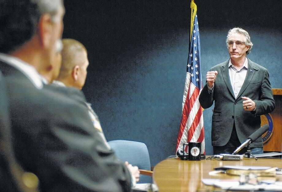 New North Dakota Gov. Doug Burgum, right, speaks with cabinet members on his first day of office Thursday at the state Capitol in Bismarck. There are 17 cabinet positions with Burgum replacing a few of the positions with new members or with people filling in for the interim during the transition from former Gov. Jack Dalrymple's administration. Mike Mccleary | The Bismarck Tribune via AP