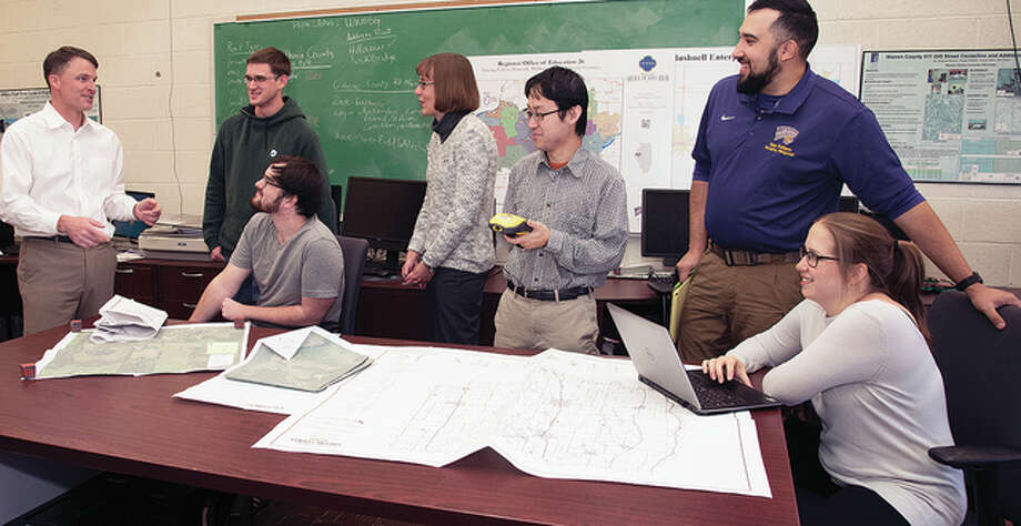 Photo provided GIS Director Chad Sperry workers with Western Illinois University senior Zack Riel (from left), graduate student Alex Adams, employee Renee Buker, GIS specialist Keisuke Nozaki, junior Edgar Rodriguez and senior Lexi Araoz.