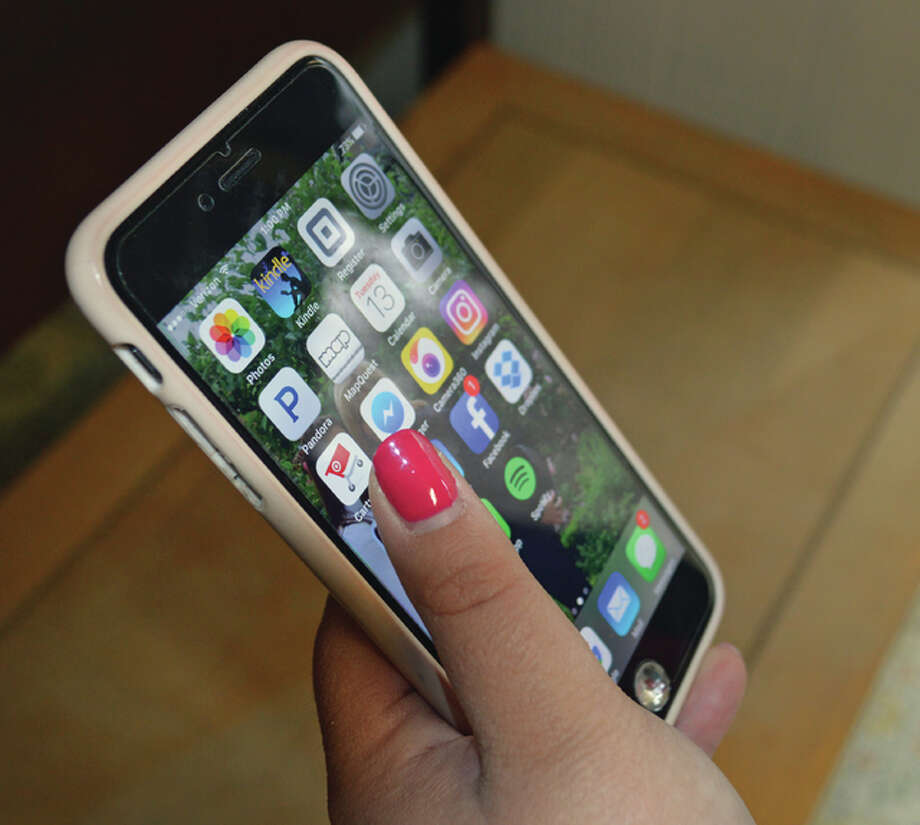 Cell phone usage is a relatively new phenomenon in the manners department — especially concerning children at a family party or in other social situations. Etiquette Saint Louis/Chicago owner Melenie Broyles said it would be great if adults and children would all make a point to put phones away and enjoy family time. Photo: For The Telegraph