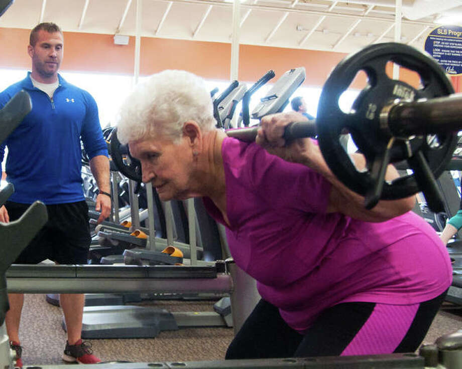 Trainer John Wright, of Club Fitness in Wood River, watches his student, Shirley Webb, now 80 but who was 79 at the time, do back squats. Webb was Wright's first student when he became a trainer at the Wood River gym. Photo: File Photo