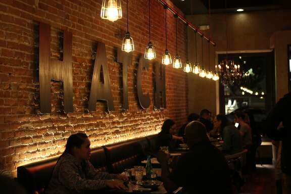 Customers dine at the Hatch Rotisserie and Bar, a popular restaurant  in downtown Paso Robles.