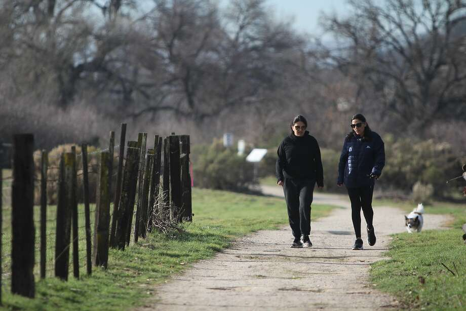 Walkers stroll the Salinas River Walk path in Paso Robles. Photo: Spud Hilton, The Chronicle