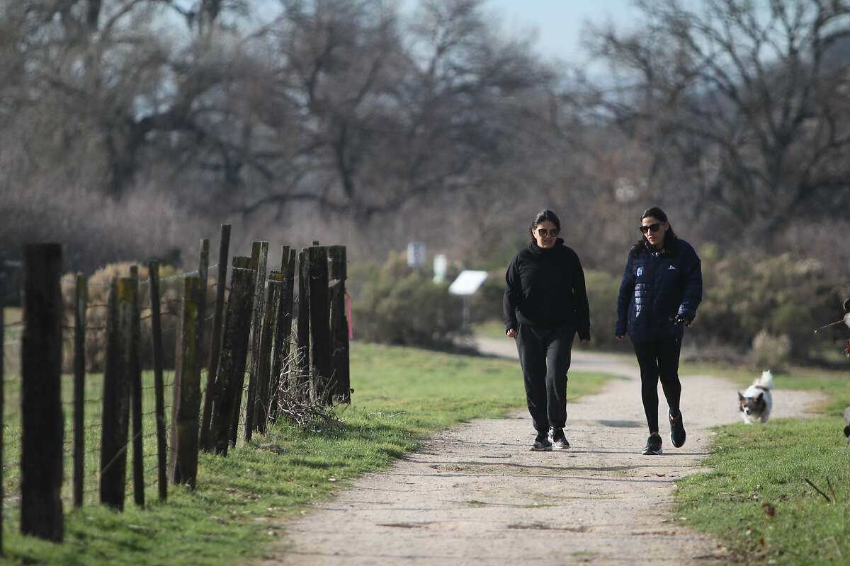 Walkers stroll the Salinas River Walk path in Paso Robles.