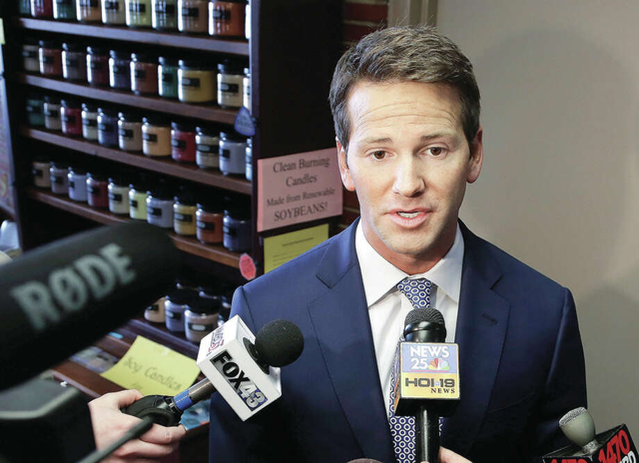 Seth Perlman | AP Former U.S. Rep. Aaron Schock speaks to reporters in Peoria. A federal judge is being asked to delay Schock's trial on charges that he used government and campaign money to subsidize a lavish lifestyle, as well as pocketing thousands of constituents' dollars.