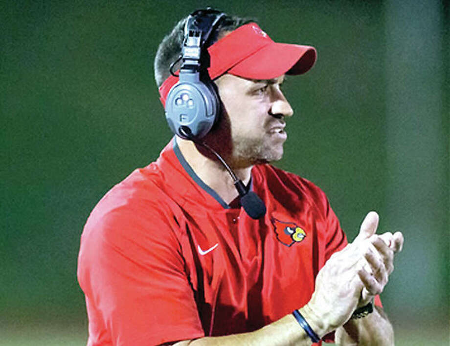 Alton coach Eric Dickerson's Redbirds will travel to Chicago to face Chicago Lincoln Park Friday in the opening round of the IHSA Class 7A state football playoffs. Photo: Scott Kane | For The Telegraph