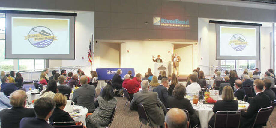 Monica Bristow, president of the RiverBend Growth Association, speaks during the 2017 State of the RiverBend luncheon, held Thursday at Lewis and Clark Community College. Standing next to her is Growth Association Chairman Augie Wuellner. The program included the presentation of six Captain of the RiverBend awards.