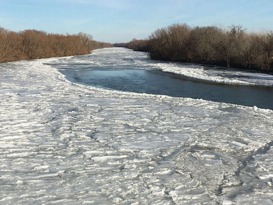 Reminders of the weekend snow and ice linger along the Sangamon River in Mason County. Photo: Joy Harris | Reader Photo