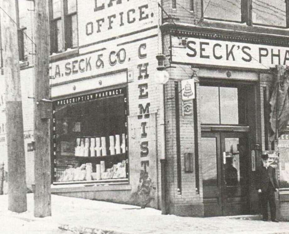 The ever-changing face of the Laura Building is seen in this photograph taken while the Seck Drug Store was located on the corner from 1905 through 1909. Photo: File Photo