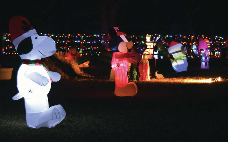 Snoopy and dozens of other cartoon characters come to life at the display at the home of Todd and Rhonda Clayton east of Concord.