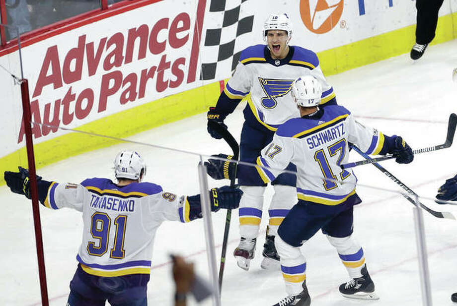 The Blues' Brayden Schenn (10) celebrates his goal with Vladimir Tarasenko (91) and Jaden Schwartz (17) in the third period of Friday night's game against the Carolina Hurricanes in Raleigh, N.C. Photo: AP