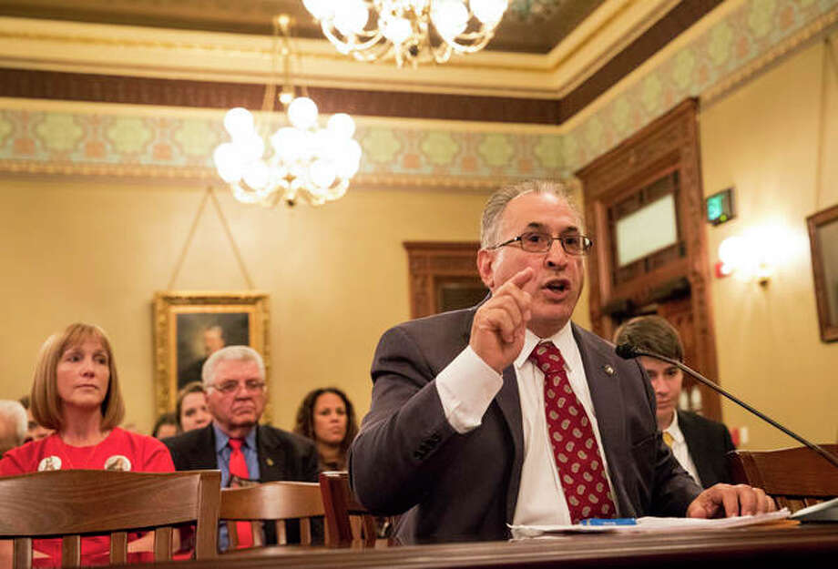 """In this Oct. 24, 2017 file photo, Rep. Martin Moylan, D-Des Plaines, testifies at a House Judiciary Committee hearing on behalf of HB 4117, a bill to ban bump stock attachments for guns that he sponsors at the Capitol in Springfield, Ill. The Illinois House Thursday, Oct. 26, 2017 soundly rejected a ban on """"bump stocks"""" of the type used in the Las Vegas massacre which speed up weapons firing. Democrats as well as Republicans complained Rep. Moylan's bill was too broad. Photo: Rich Saal/The State Journal-Register Via AP File"""