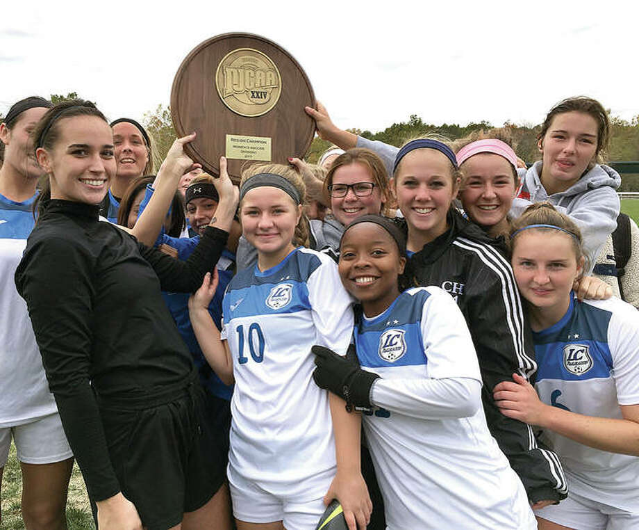 Members of the Lewis and Clark Community College women's soccer team celebrate with the NJCAA Region 24 championship plaque Sunday afternoon at LCCC. The Trailblazers rallied to defeat rival SWIC 3-1. Photo: Telegraph Photo