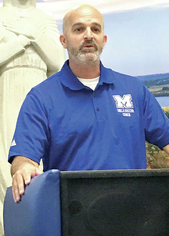New Marquette girls soccer coach Brian Hoener addresses students and media gathered in the MCHS Commons Monday. He is also the women soccer coach at Fontbonne University. Photo: Telegraph Photo