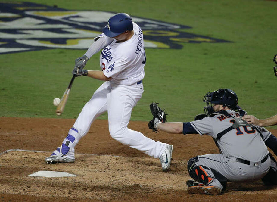 The Dodgers' Joc Pederson hits a home run against the Astros during the seventh inning of Game 6 of the World Series on Tuesday night in Los Angeles. Photo: Associated Press