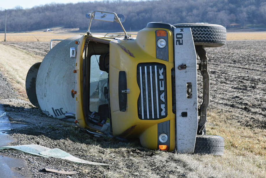 A concrete truck overturned about 10:15 a.m. Thursday on Illinois Route 104, just east of Meredosia. The driver, whose name was unavailable, was taken to Passavant Area Hospital for treatment of minor injuries, according to Illinois State Police. Photo: Nick Draper | Journal-Courier