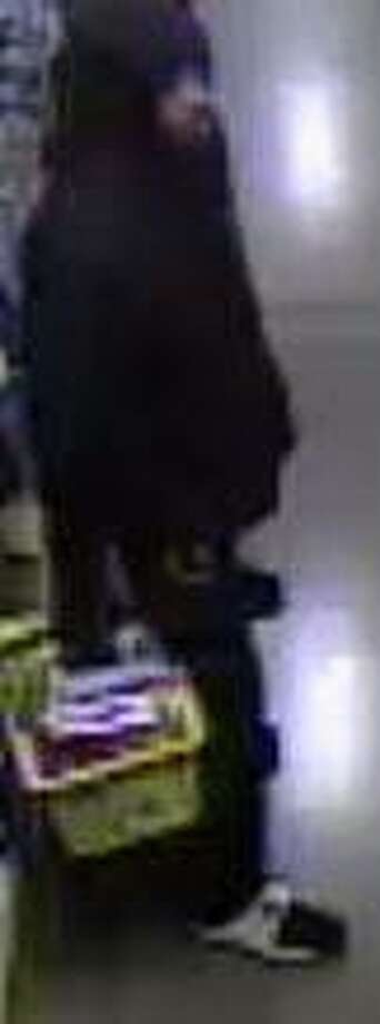 Surveillance photos of the armed robbery suspect. Photo: For The Telegraph