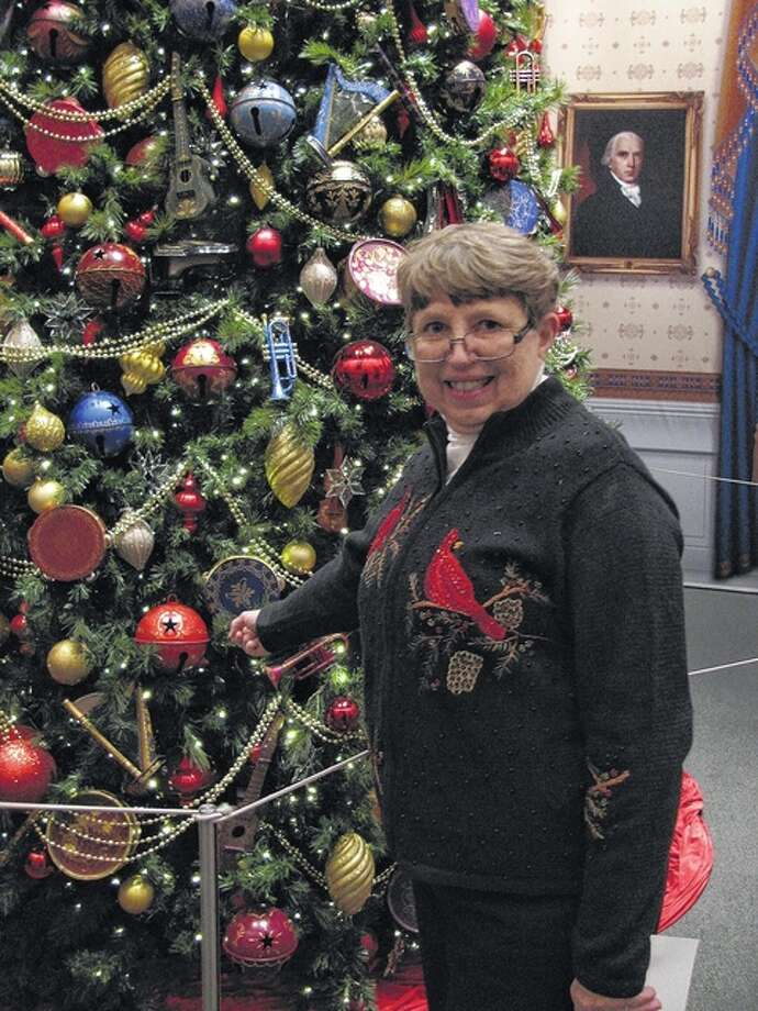 "Elizabeth ""Betty"" Niemann stands next to the section of a Christmas tree at the George W. Bush Presidential Library and Museum in Dallas that holds an ornament she made in 2004. Photo: Photo Courtesy Of Elizabeth Niemann"
