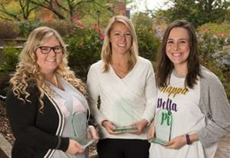 Displaying three of their four Achieving Chapter Excellence Awards are Lambda Theta Chapter of Kappa Delta Pi (KDP) International Honor Society in Education members (L-R): Sierra Hyman, KDP co-president a senior elementary education major; Barbara Martin, KDP faculty advisor; and Kalli Hentis, KDP co-president and senior majoring in speech-language pathology. Photo: For The Telegraph